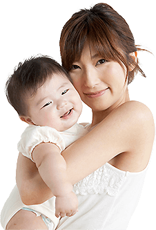 Asian woman holding baby